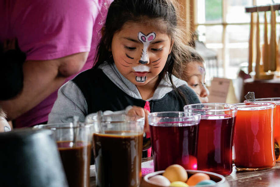 Despite the rainy weather, the Easter Bunny brought more than 1,000 eggs to the 1820 Col. Benjamin Stephenson House on Saturday. The house also welcomed everyone to learn how naturally dye eggs, get their faces painted and play games. Photo: Breanna Booker | The Intelligencer