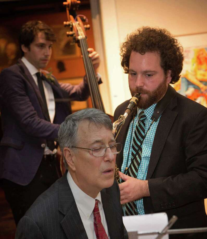 """The Library Suite,"" a multi-media jazz premiere, is taking place at the Pequot Library in Fairfield April 28. The music is by Fairfield resident Mark Edinberg, front, who will perform with his sons, Dan (bass) and Joel Edinberg (sax and a new woodwind instrument called a Vindor ES1). Photo: Mark Edinberg / Contributed Photo"