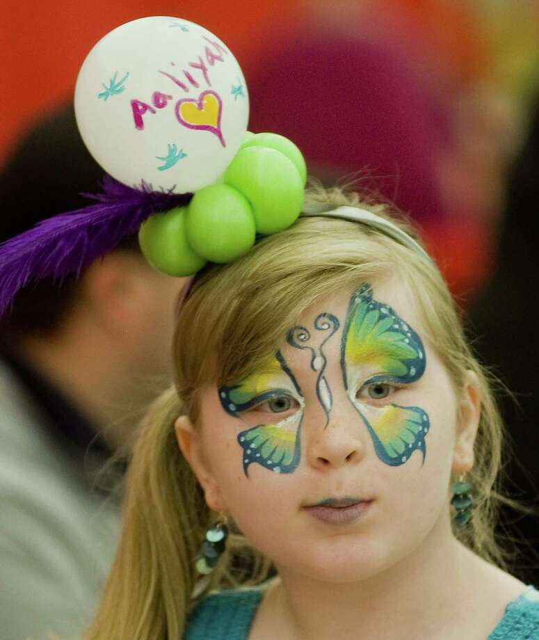 Aaliyah Frank, of Danbury, with adornments applied at the Danbury Kids Expo's 5th annual event held at the Danbury Sports Dome in 2015. The event returns May 5. Photo: Hearst Connecticut Media File Photo / The News-Times Freelance