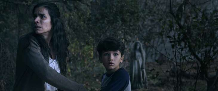 Patricia Velasquez (left) stars in the new horror film 'The Curse of La Llorona' as a mom struggling to protect her children from the title terror.