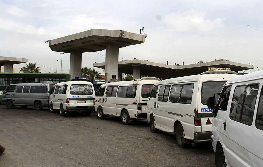 Vans line up to fill their tanks at a gas station in Daraa. Syrians are now facing widespread fuel shortages. Photo: Syrian Arab News Agency