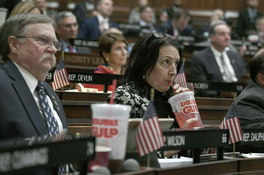 State Rep. Anne Dauphinais, R-Killingly, takes a sip from a Big Gulp soda as Gov. Ned Lamont delivers his budget address at the State Capitol in Hartford in February. Lamont proposed a tax on sugary drinks in his first budget. Connecticut is among several states likely to see debate this year over taxes that advocates endorse as way to reduce consumption of liquid calories. On March 25, the American Academy of Pediatrics and the American Heart Association called for education campaigns and raising prices through taxes to reduce consumption of sugary drinks by young people. Photo: Jessica Hill / Associated Press / Copyright 2019 The Associated Press. All rights reserved