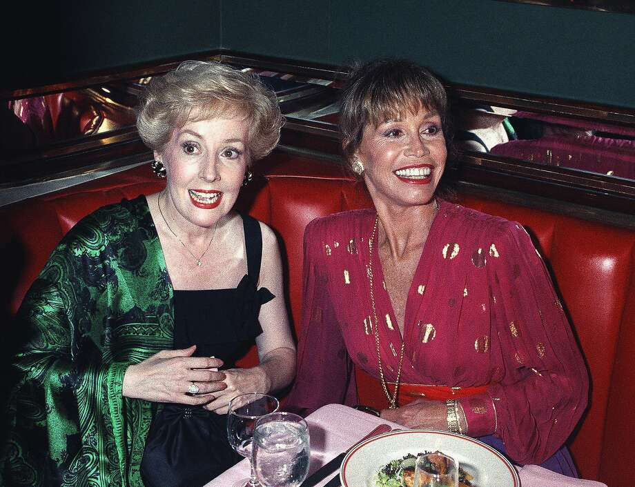 Georgia Engel (left) sits next to Mary Tyler Moore at an Emmy Awards screening party in 1992 in New York. Engel played Georgette on Moore's popular show between 1972 and 1977. Photo: Malcolm Clarke / Associated Press 1992