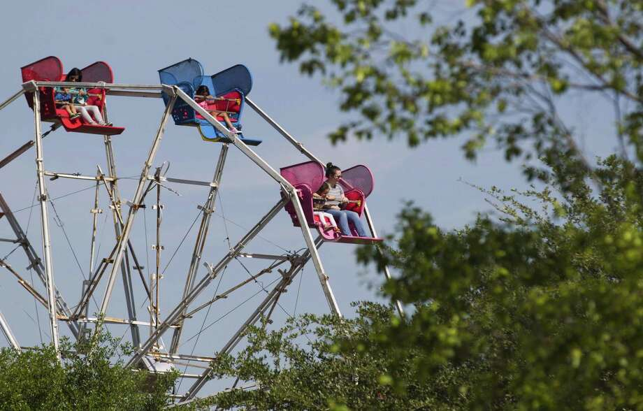 Residents enjoy a 1940s era ferris wheel during the annual KidzFest in downtown Conroe, Saturday, April 28, 2018. This year's KidzFest is set for Saturday, April 27, in downtown Conroe. Photo: Jason Fochtman, Staff Photographer / Houston Chronicle / © 2018 Houston Chronicle