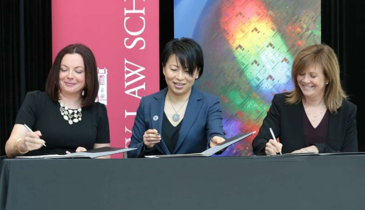 Heather Hage of SUNY RF, Grace Wang of SUNY Poly and Alicia Ouellette of Albany Law school signed an agreement to create the Innovation Intensive program on Tuesday April 16, 2019.