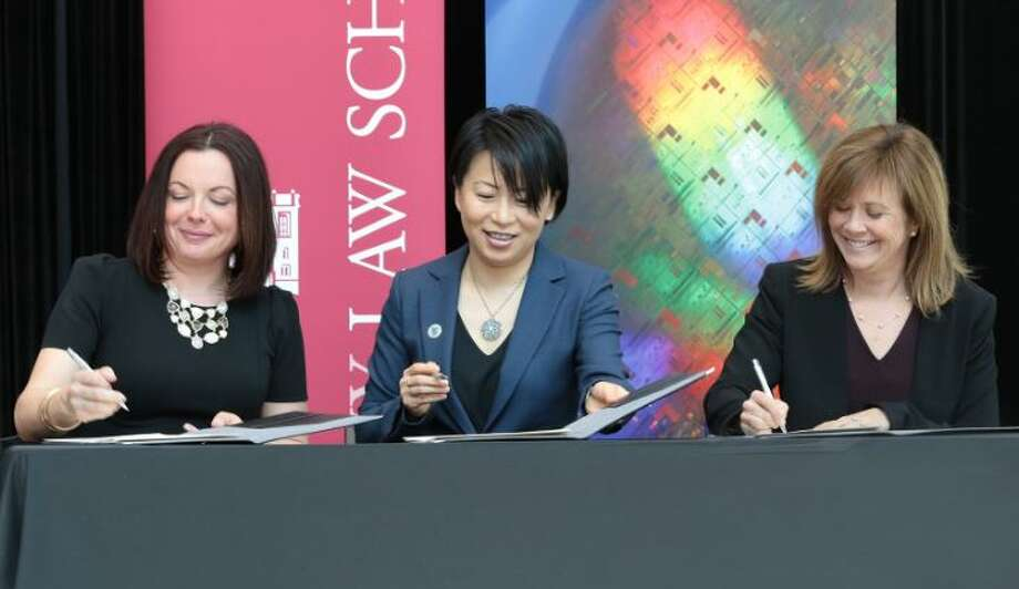 Heather Hage of SUNY RF, Grace Wang of SUNY Poly and Alicia Ouellette of Albany Law school signed an agreement to create the Innovation Intensive program on Tuesday April 16, 2019. Photo: SUNY Poly