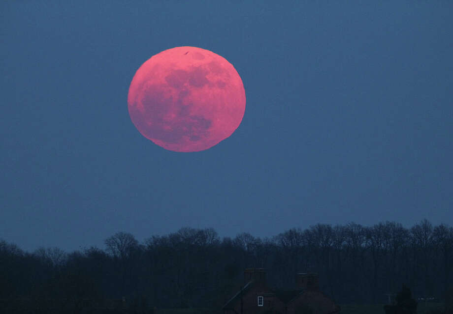 "April's ""Pink Moon"" will be at peak fullness this Friday, April 19. Keep clicking to see the best spots to view the sky from around San Antonio. Photo: Jamie Cooper / Getty Images / SSPL/Jamie Cooper"