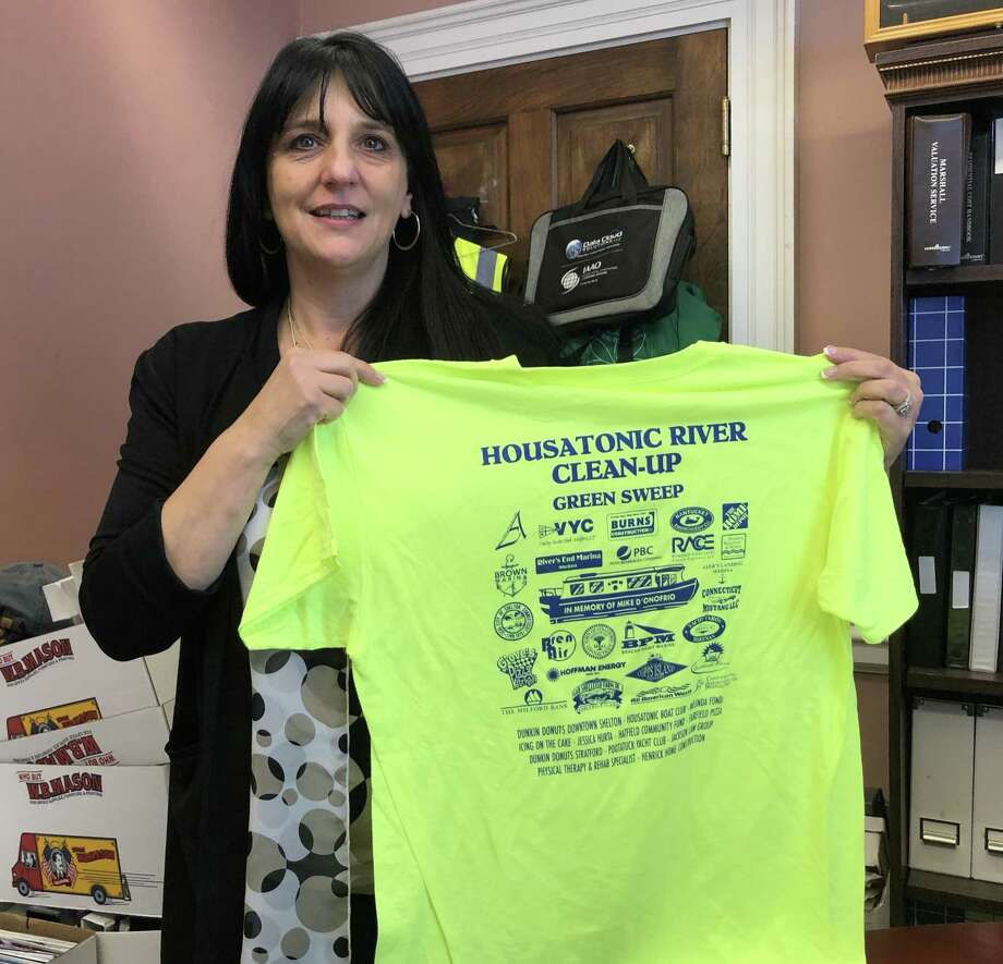 Stratford Tax Assessor Melinda Fonda, who will retire from the post April 26 to take a new job elsewhere, holds a T-shirt for the annual Housatonic River Cleanup, scheduled for April 27. Photo: Ethan Fry / Hearst Connecticut Media