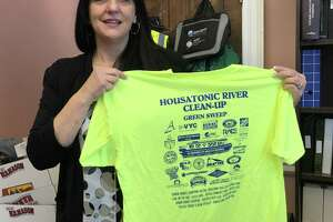 Stratford Tax Assessor Melinda Fonda, who will retire from the post April 26 to take a new job elsewhere, holds a T-shirt for the annual Housatonic River Cleanup, scheduled for April 27.
