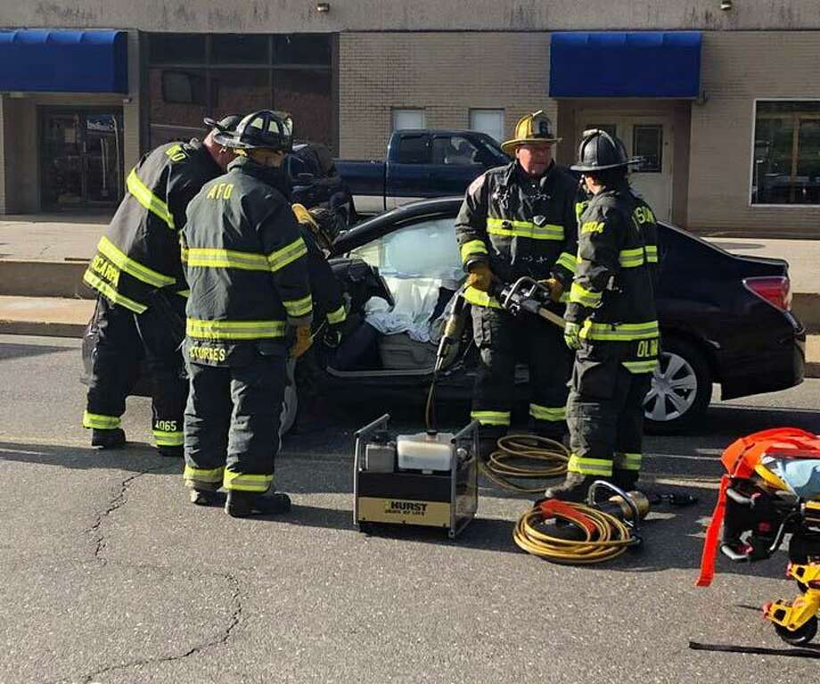 On Monday, April 15, 2019, firefighters in Ansonia, Conn., handled a crash that sent one person to the hospital. Firefighters had to remove the driver's door to get the driver out of the vehicle after the crash. Photo: Contributed Photo / Eagle Hose & Hook & Ladder Co. / Contributed Photo / Connecticut Post Contributed