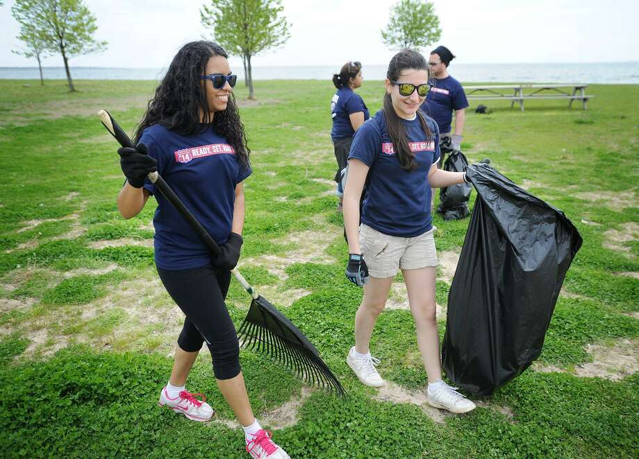 File photo showing then-Fairfield University seniors Pauline Santos, left, and Camile Gomes, clean up Seaside Park in Bridgeport Conn. on Tuesday, May 13, 2014. Photo: Brian A. Pounds / Hearst Connecticut Media / Connecticut Post