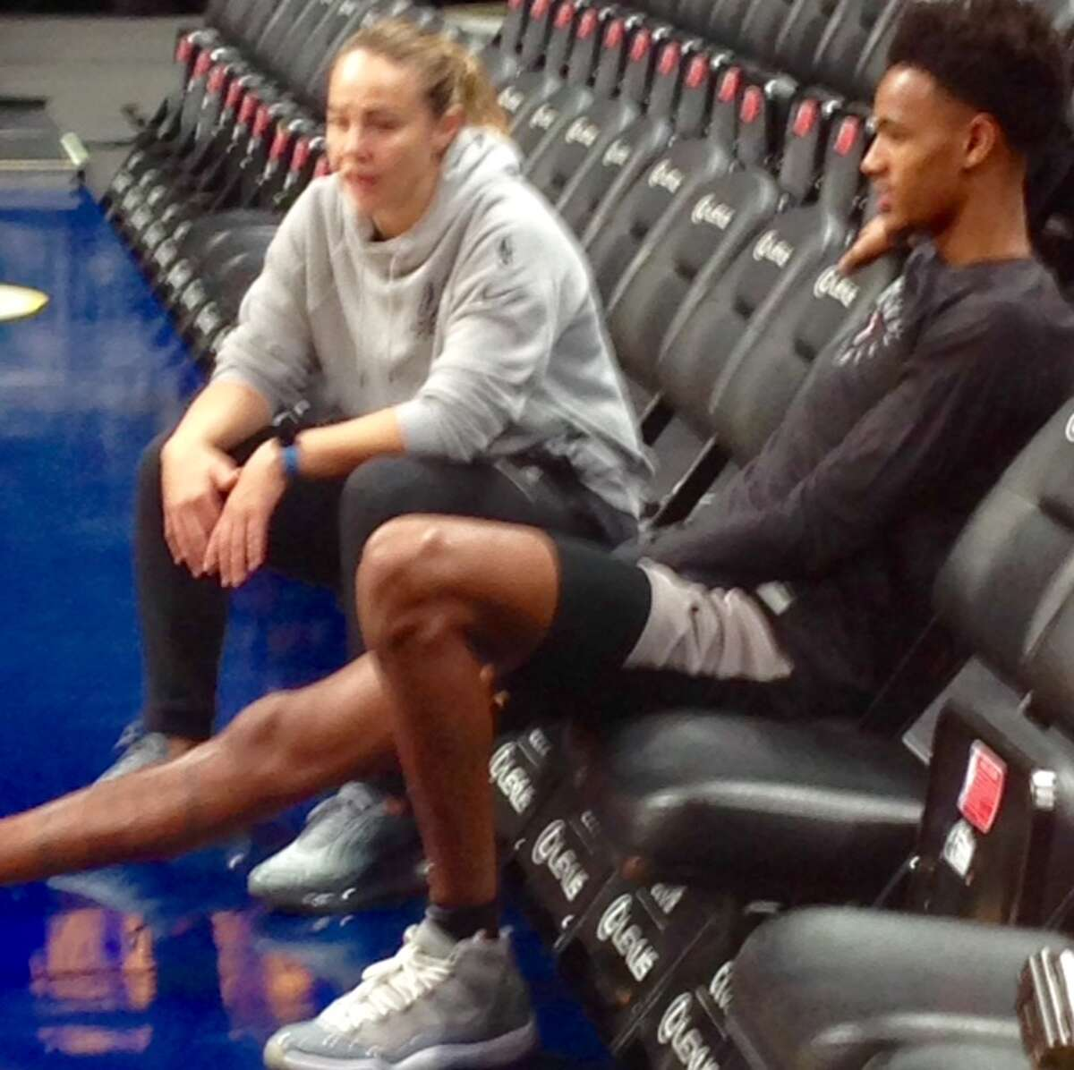 Spurs guard Dejounte Murray and assistant coach Becky Hammon talk during practice in Denver on Tuesday, April 16, 2016, prior to Game 2 of the first round of the Western Conference playoffs between the Spurs and the Nuggets.