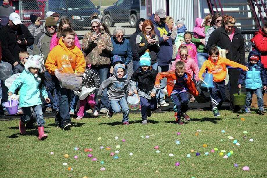 Youngsters spared no energy in pursuit of eggs and the tasty treats inside at the Cass City Easter egg hunt last Saturday morning, hosted by the Cass City Missionary Church. For more photos of the event, see Page 8A. (Seth Stapleton/Huron Daily Tribune)