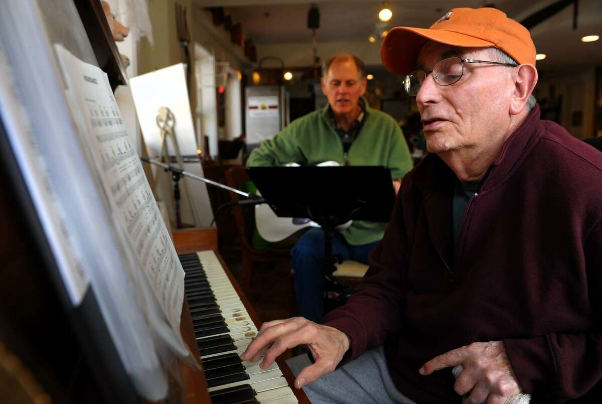 Greg Pederson, on guitar, and Joe Luciano, on piano, rehearse songs for Wednesday Night Open Mic Night at The All-American Valley General Store and Red Clover Cafe in downtown Seymour March 22, 2013.