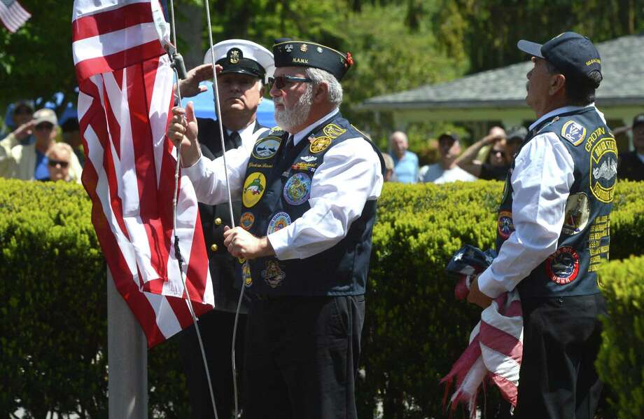 Members of the Port 5 Bridgeport Naval Veterans, Qualified Submarine Vets Paul Grammer, Mike Deleo and Craig Megargle salute and raise the colors during a ceremony that honored dignitaries and veterans from past wars during the 8th Annual Boothe Memorial Park Antique & Classic Car Show on Sunday May 21, 2017. in Stratford Conn. Proceeds from the day benefit Friends of Boothe Memorial Park & Museum, for a Seeing Eye dog for a blind veteran and other veteran non-profits. Photo: Alex Von Kleydorff / Hearst Connecticut Media / Norwalk Hour