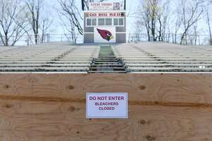 The Cardinal Stadium home bleachers are closed during the boy's lacrosse game at Greenwich High School Tuesday.