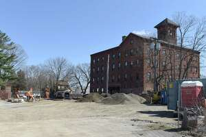 Construction takes place behind the Powers Park Lofts on Thursday, April 4, 2019 in Troy, NY. (Phoebe Sheehan/Times Union)