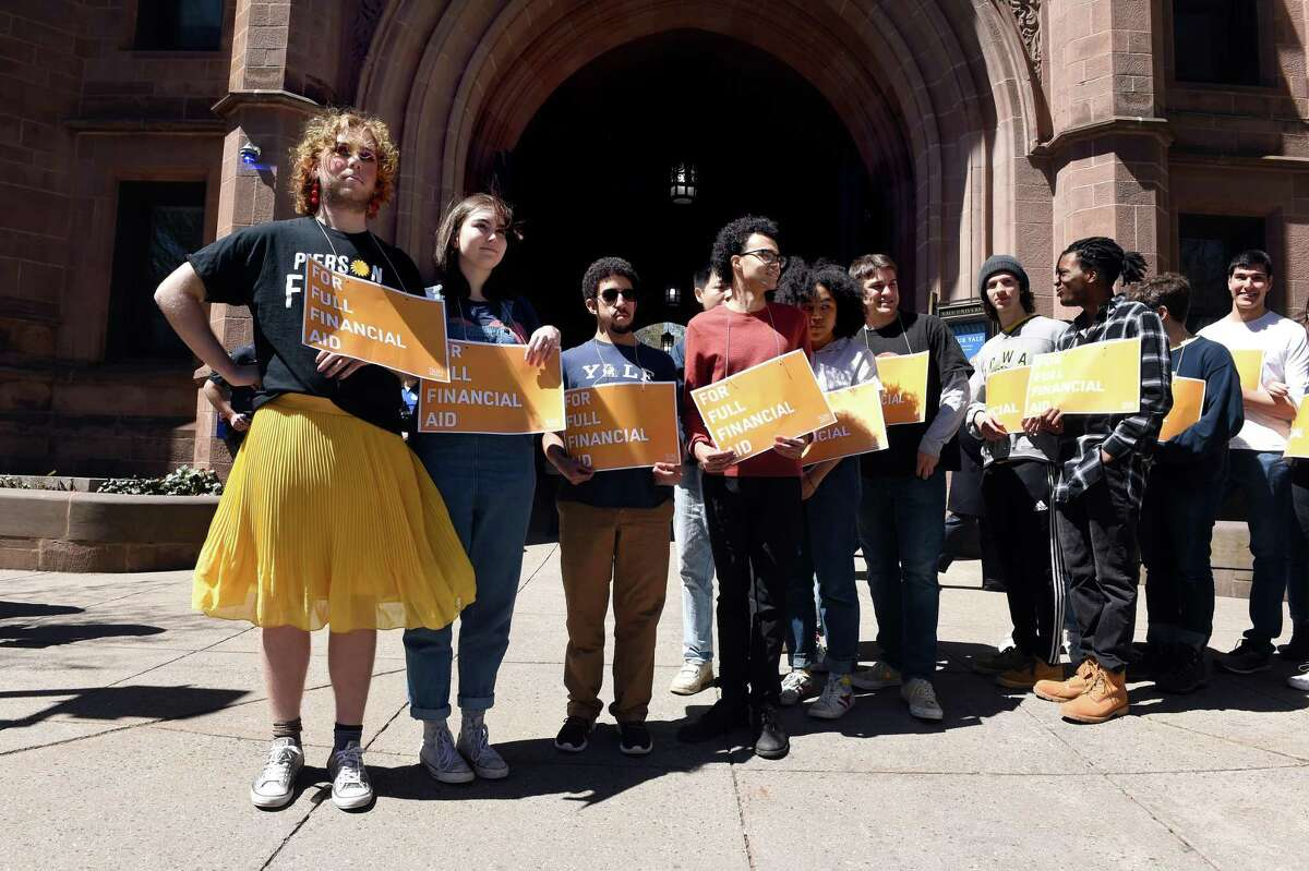 Yale University members of Students Unite Now prepare to block traffic on College Street in front of the entrance to Old Campus in New Haven to protest the required student contribution to financial aid packages on April 16, 2019.
