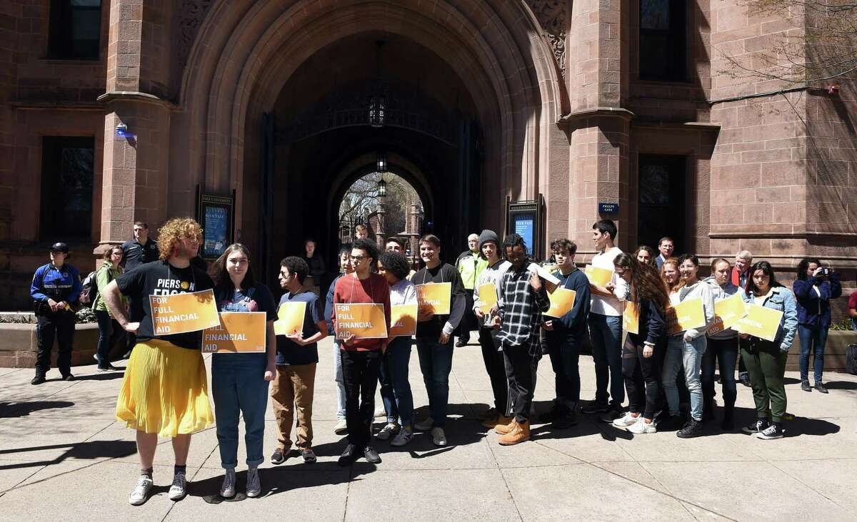 Yale University members of Students Unite Now prepare to block traffic on College Street in front of the entrance to Old Campus in New Haven on April 16, 2019, protesting the required student contribution to financial aid packages.