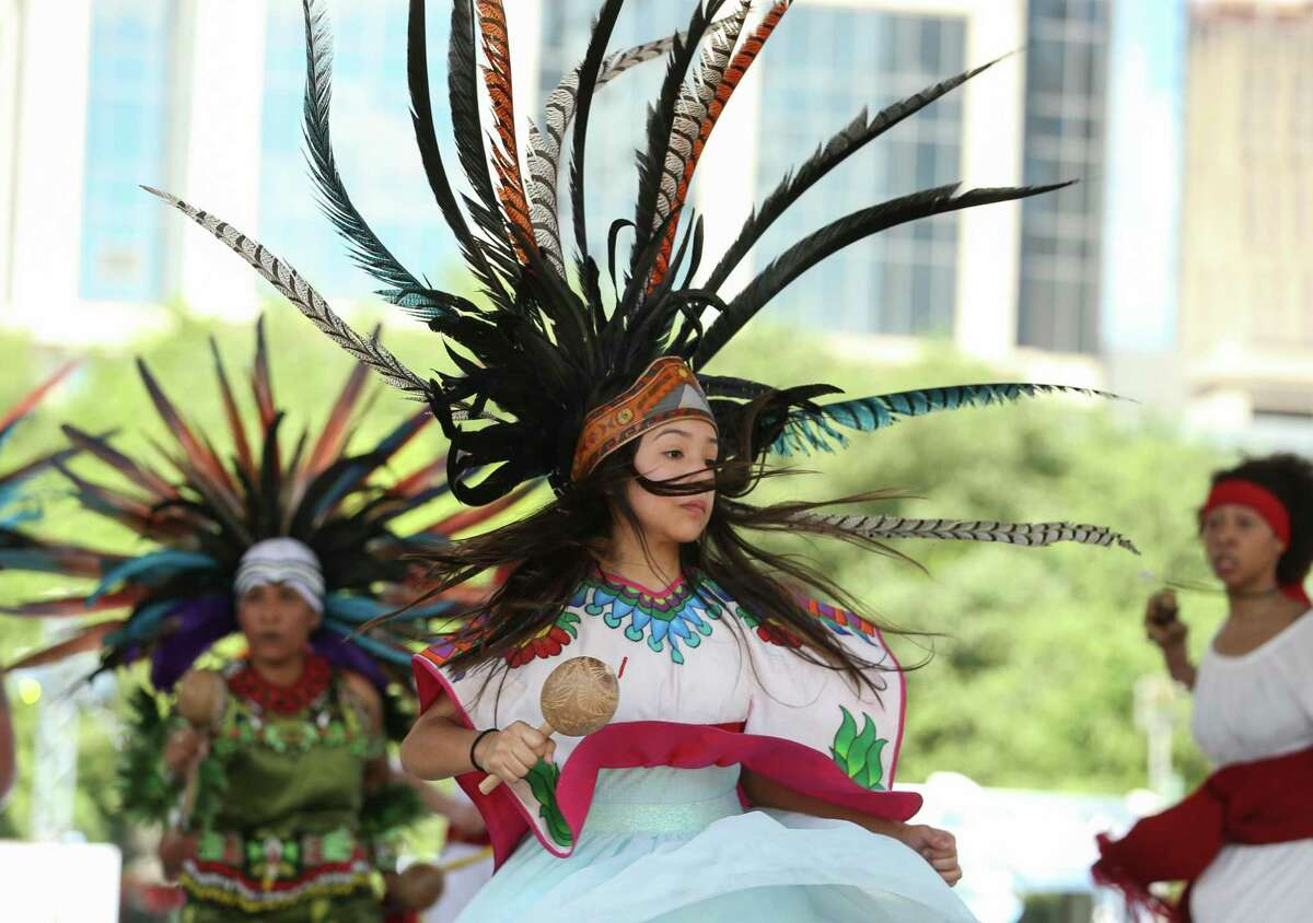 In this file photo from 2018, a Houston Aztec Dancer performs with the group at the Spring World International Festival at Discovery Green in March 2018.