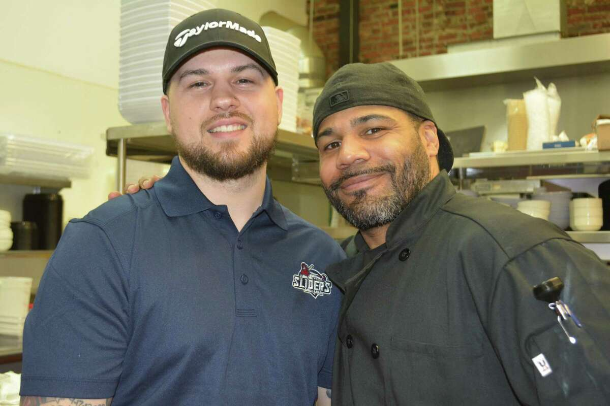Kitchen Managers Roland Grenier of Torrington, left and Peter Black of New Britain prepare for a private gathering Tuesday before the restaurant opens to the public on Wednesday, April 17 at 4 p.m.