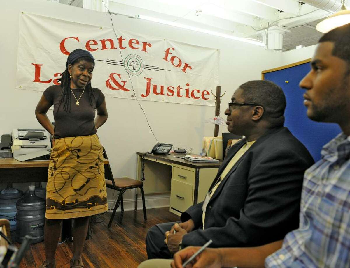 Alice Green speaks with employees Darrel Johnson and Lafonso Bonner, right, in her office of the Center for Law and Justice in Albany. (Skip Dickstein/Times Union)