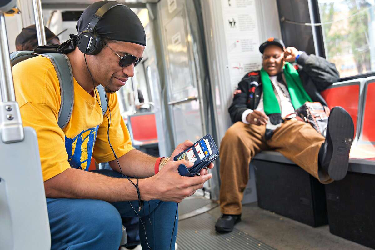 Duane Fassett rides the T muni line inbound on Tuesday, April 16, 2019. San Francisco, Calif.