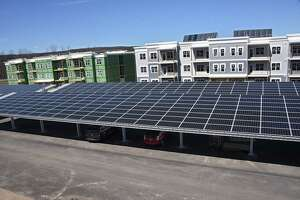 Solar panels cover the car ports at the Solara Apartments on Tuesday, April 16, 2019 in Rotterdam, N.Y. The apartments are solar powered. The New York State Energy Research and Development Authority (NYSERDA) and ASHRAE, the American Institute of Architects New York State and David Bruns Realty announced the grand opening of the first phase of Solara Apartments. The new multi-family development is built to net zero construction standards. (Lori Van Buren/Times Union)