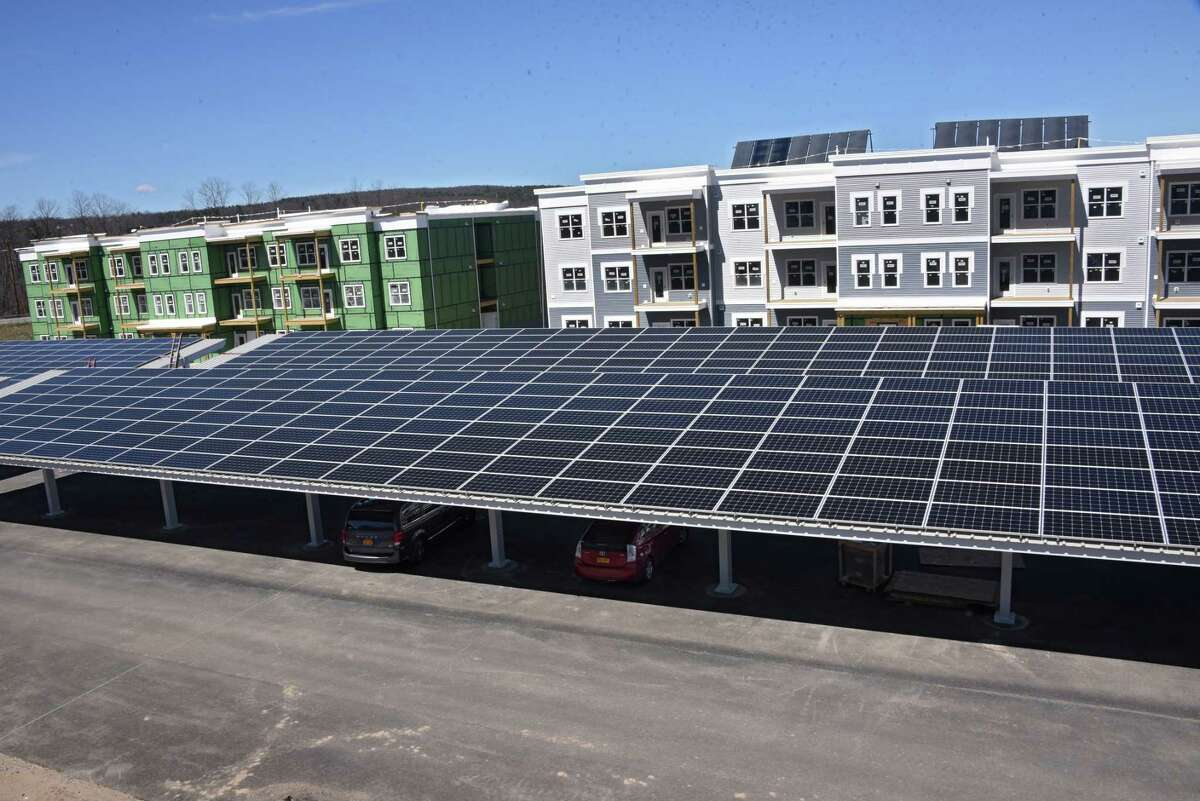 Solar panels cover the car ports at the Solara Apartments on Tuesday, April 16, 2019 in Rotterdam, N.Y. (Lori Van Buren/Times Union)