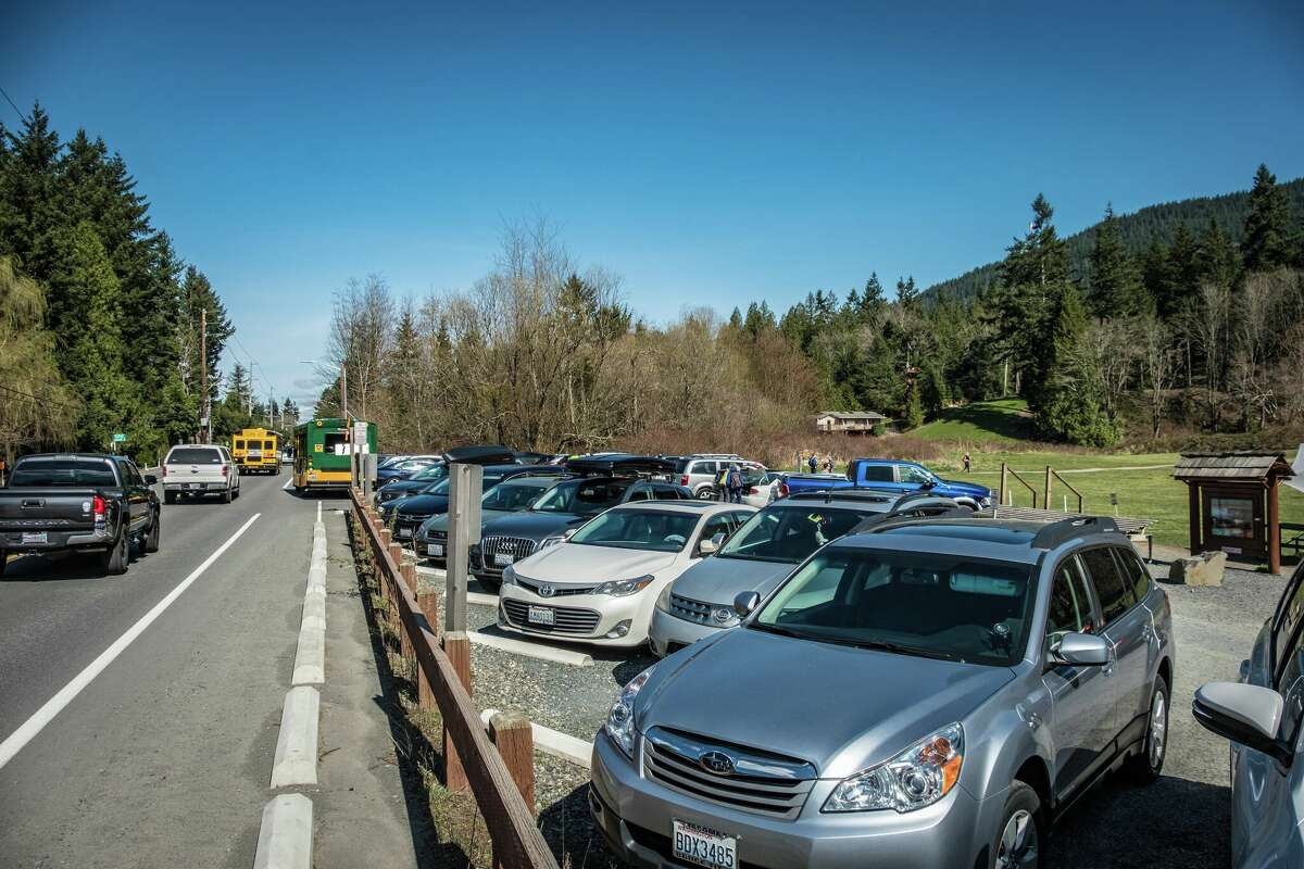 Parking lots, like the one at Poo Poo Point pictured here, often fill up at popular hiking spots.