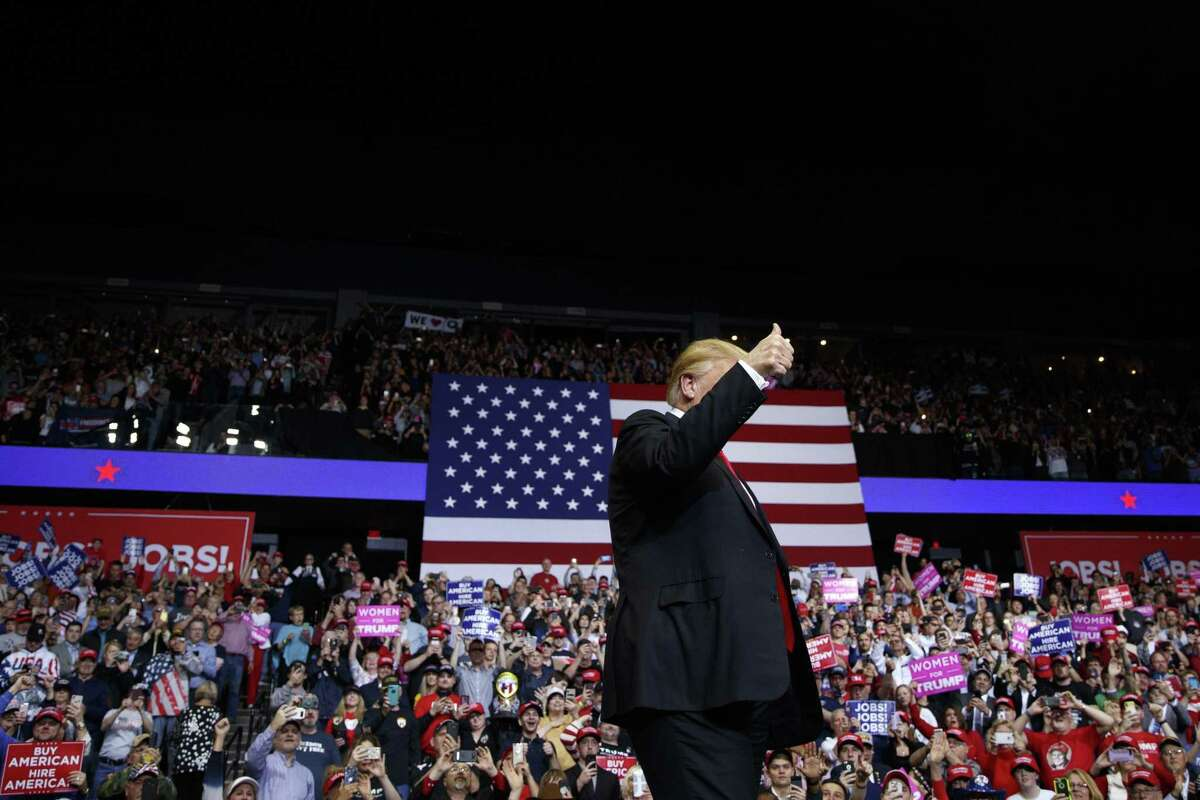 President Donald Trump delivers remarks during his rally in Grand Rapids, Mich., March 28. Politics has deteriorated into team sport, in which the opposing team is the enemy.