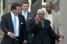 The founding superintendent of Houston's Varnett charter school, Marian Annette Cluff, and her husband, Alsie Cluff Jr., the school's former facilities manager, leave the courtroom with their attorneys, Dan Cogdell and Cordt Akers. The Cuffs turned themselves into federal authorities in 2015 after being indicted on charges of embezzling more than $2.6 million from the school network. ( Dylan Aguilar / Houston Chronicle )
