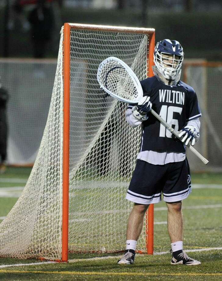 Wilton goalie Andrew Calabrese against New Canaan on April 9. Photo: Matthew Brown / Hearst Connecticut Media / Stamford Advocate