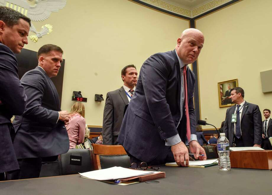 Then-acting Attorney General Matthew Whitaker collects his papers as the House Judiciary Committee takes a temporary adjournment from his February 2019 testimony. Photo: Washington Post Photo By Bill O'Leary. / The Washington Post