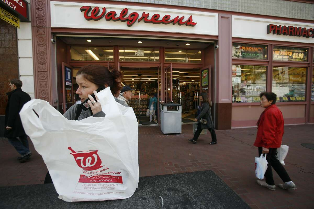 Anna Sager of San Francisco, Calif. holds newly purchased goods in a new degradable (not necessarily biodegradable) Walgreens bag in front of the 850 Market Street store on Monday May 19, 2008 in San Francisco, Calif. The store is in the process of phasing out non-degradable plastic bags in preparation for the city-wide ban on them starting May 20, 2008. Photo by Mike Kepka / San Francisco Chronicle
