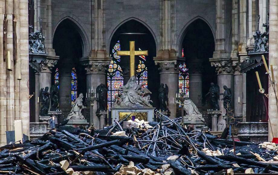 Debris are seen inside Notre Dame cathedral in Paris, Tuesday, April 16, 2019. Firefighters declared success Tuesday in a more than 12-hour battle to extinguish an inferno engulfing Paris' iconic Notre Dame cathedral that claimed its spire and roof, but spared its bell towers and the purported Crown of Christ. (Christophe Petit Tesson, Pool via AP) Photo: Christophe Petit Tesson, Associated Press