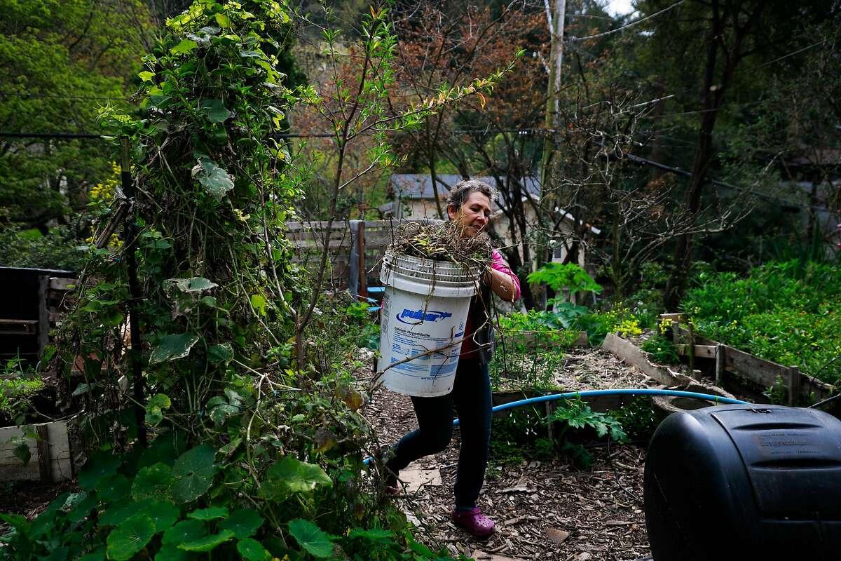 Jeannie McKenzie gardens on her homestead in Oakland, California, on Monday, April 1, 2019.