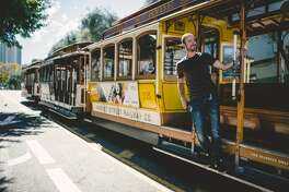 SAN FRANCISCO Ca. - September 26: Passenger ride in a cable car on September 26, 2015 in San Francisco. It is the most popular way to get around the City of San Fransisco. San Francisco cable car