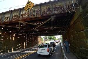 Traffic goes under the railroad bridge spanning East Ave. in Norwalk, Conn. Friday, May 27, 2016. The Connecticut Department of Transportation project to replace the Walk Bridge over the Norwalk River also includes plans to replace other Metro-North bridges along the New Haven Line including the spans over East and Osbourne avenue.