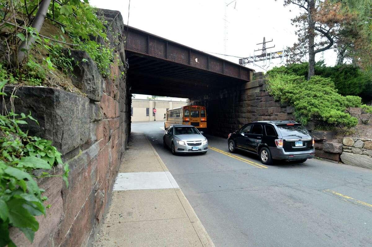 Traffic flows under the Fort Point Street Metro-North railroad bridge in Norwalk.