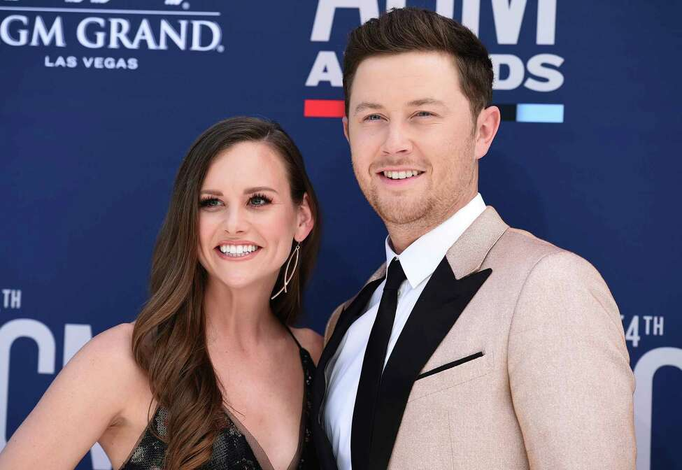 Scotty McCreery, right, and Gabi Dugal arrive at the 54th annual Academy of Country Music Awards at the MGM Grand Garden Arena on Sunday, April 7, 2019, in Las Vegas.