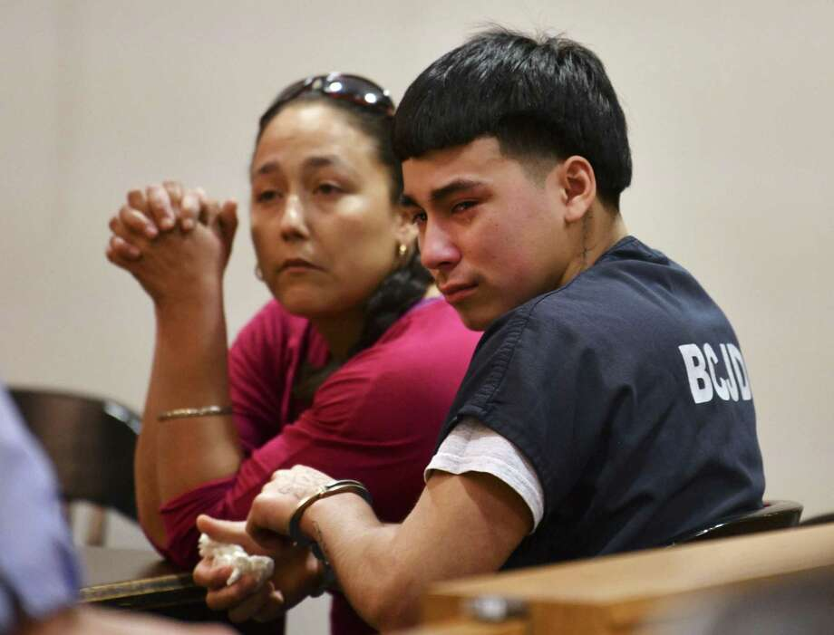 Raul Cervera weeps as he sits with his mother, Rosenda Armendariz, during a hearing at which he was certified as an adult to stand trial in a capital murder case. Cervera is charged with shooting Abram Garcia IV to death in 2018. Judge Lisa K. Jarrett presided over the hearing on Tuesday, April 16, 2019. Photo: Billy Calzada, Staff / Staff Photographer / San Antonio Express-News