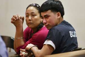 Raul Cervera weeps as he sits with his mother, Rosenda Armendariz, during a hearing at which he was certified as an adult to stand trial in a capital murder case. Cervera is charged with shooting Abram Garcia IV to death in 2018. Judge Lisa K. Jarrett presided over the hearing on Tuesday, April 16, 2019.