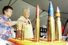 In this October 2016 file photo, Rita and Floyd Albers look over a display of ammunition at Olin Brass's celebration of its 100th anniversary in East Alton. Floyd worked for the brass mill in 1949.