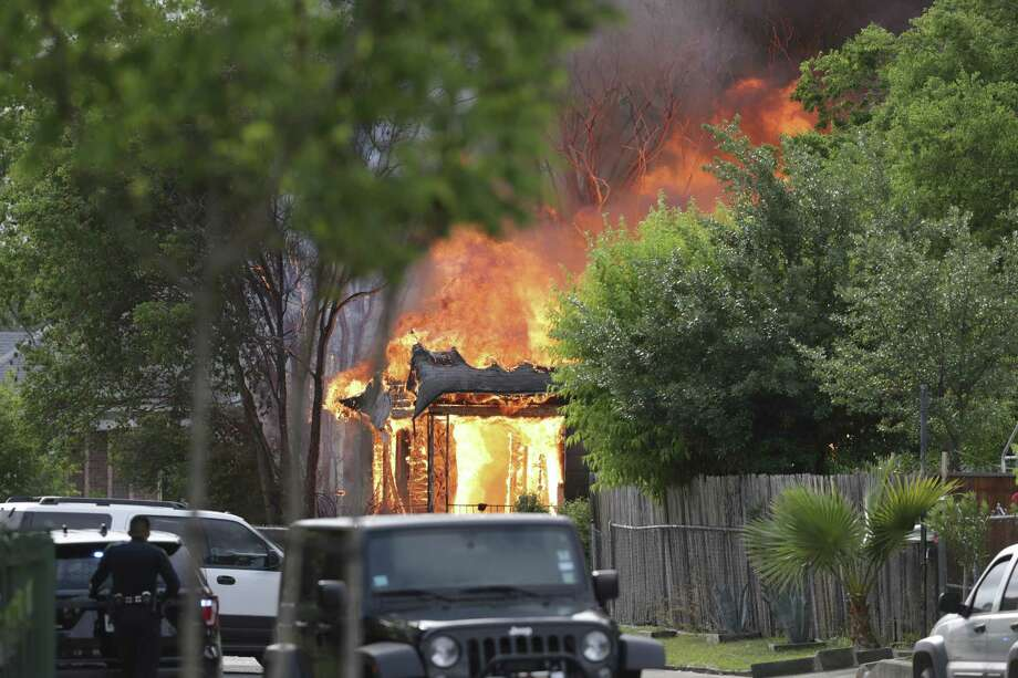 Firefighters work to control a fire at 200 Beldon Avenue involving SWAT team members on April 16, 2019. Photo: Tom Reel, Staff / Staff Photographer / 2019 SAN ANTONIO EXPRESS-NEWS