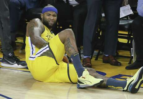Golden State Warriors DeMarcus Cousins lies on the floor with an apparent injury in the first quarter during game 2 of the Western Conference Playoffs between the Golden State Warriors and the Los Angeles Clippers at Oracle Arena on Monday, April 15, 2019 in Oakland, Calif.