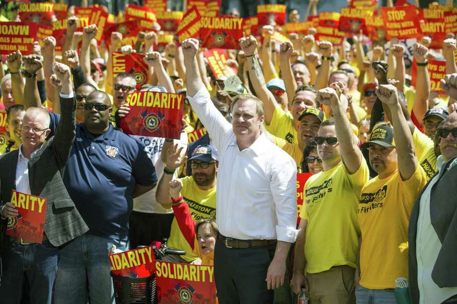 Marty Lancton, the head of the Houston Professional Fire Fighters Association, stands with his membership during a march on City Hall over the labor dispute related to Proposition B on Tuesday, March 19, 2019, in Houston. Photo: Brett Coomer, Houston Chronicle / Staff Photographer / © 2019 Houston Chronicle
