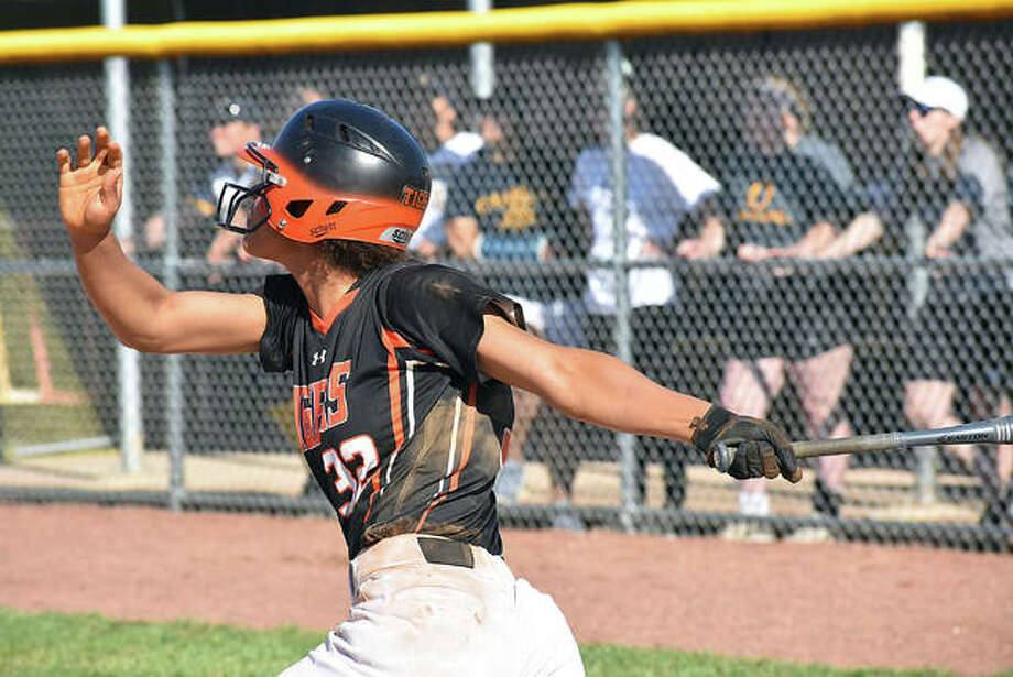 Edwardsville's Maria Smith watches her solo home run leave the yard in the second inning against O'Fallon on Tuesday in Southwestern Conference action. Photo: Matt Kamp/The Intelligencer