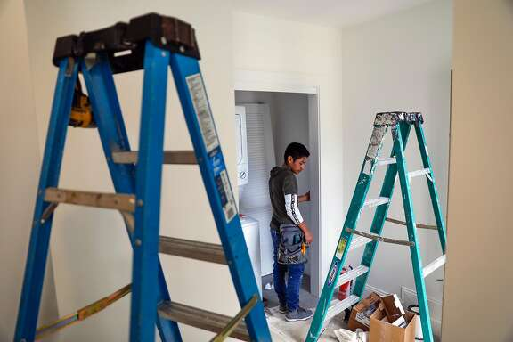 Construction worker Felix Guzman put the finishing touches on an apartment that was converted from a garage into an rental unit on Roanoke Street in San Francisco, California, on Tuesday, March 26, 2019.