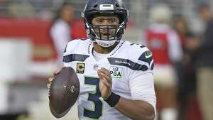 Russell Wilson of the Seattle Seahawks looks to pass the ball against the San Francisco 49ers during the Niners 26-23 overtime win over the Seahawks Sunday, December 16, 2018 at Levi's Stadium in Santa Clara, CA.